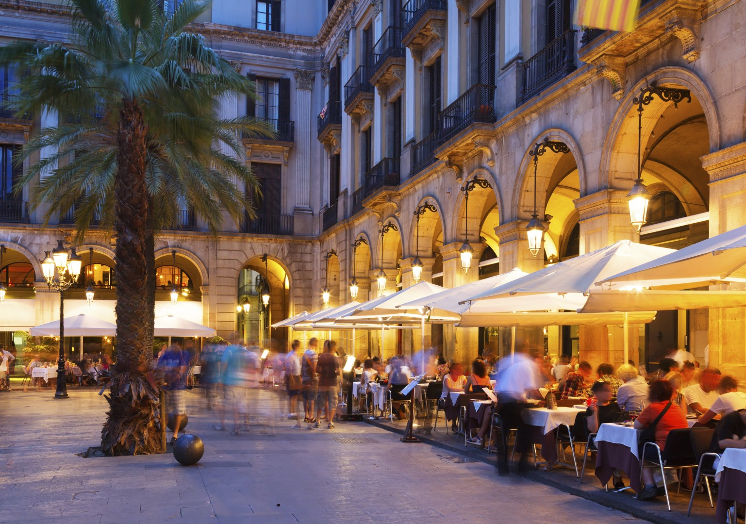 Night view of Placa Reial with restaurants in summer. Barcelona.